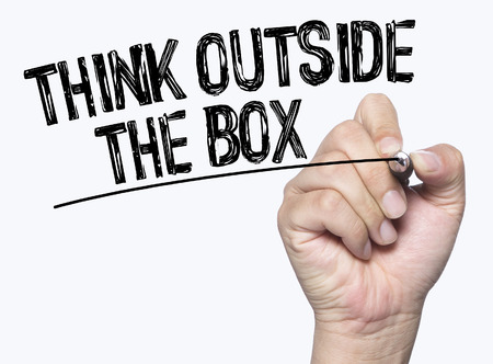 outside the box: think outside the box written by hand, hand writing on transparent board, photo Stock Photo