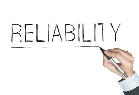 rely: reliability written by hand, hand writing on transparent board, photo Stock Photo