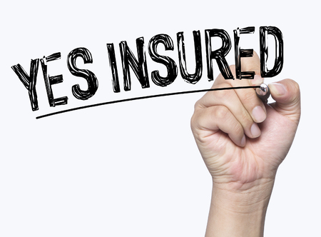 insured: yes insured written by hand, hand writing on transparent board, photo