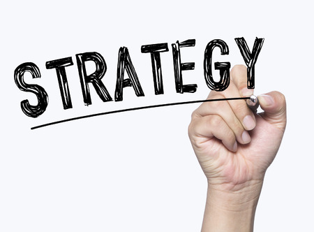 strategy written by hand, hand writing on transparent board, photo Stock Photo
