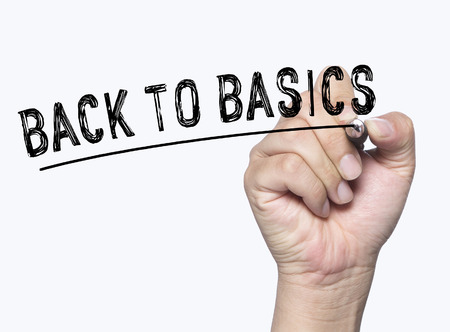 basics: back to basics  written by hand, hand writing on transparent board, photo