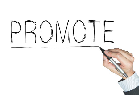 promote: promote written by hand, hand writing on transparent board, photo Stock Photo