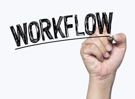 workflow written by hand, hand writing on transparent board, photo Stock Photo