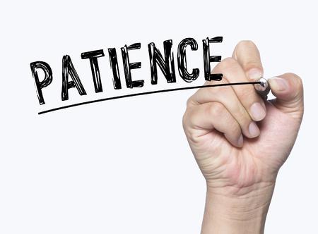paciencia: paciencia escrita a mano, escritura de la mano a bordo transparente, foto