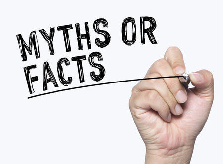 myths or facts written by hand, hand writing on transparent board, photo Stockfoto