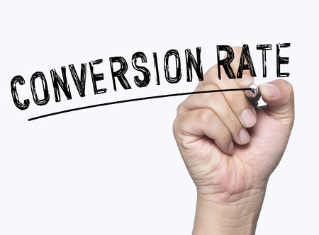 conversion: conversion rate written by hand, hand writing on transparent board, photo