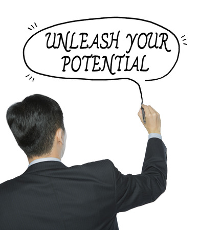 unleash: unleash your potential  written by businessman in black suit, hand writing on transparent board, photo