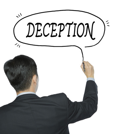 deception: deception written by businessman in black suit, hand writing on transparent board, photo