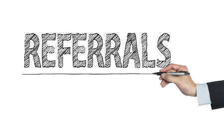 referidos: referrals written by hand, hand writing on transparent board, photo