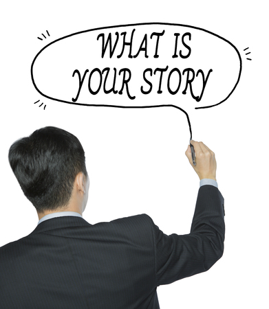 photo story: what is your story written by businessman in black suit, hand writing on transparent board, photo