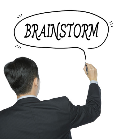 provoke: brainstorm written by businessman in black suit, hand writing on transparent board, photo