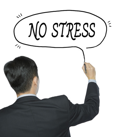 slump: no stress written by businessman in black suit, hand writing on transparent board, photo Stock Photo