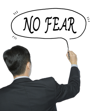 no fear: no fear written by businessman in black suit, hand writing on transparent board, photo