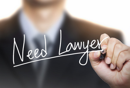 lawyer: need lawyer written by hand, hand writing on transparent board, photo
