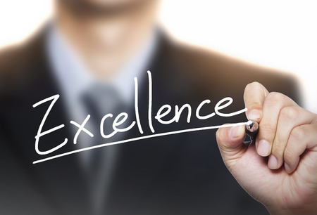 excellence: excellence written by hand, hand writing on transparent board, photo