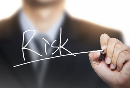 risk written by hand, hand writing on transparent board, photo Stock Photo