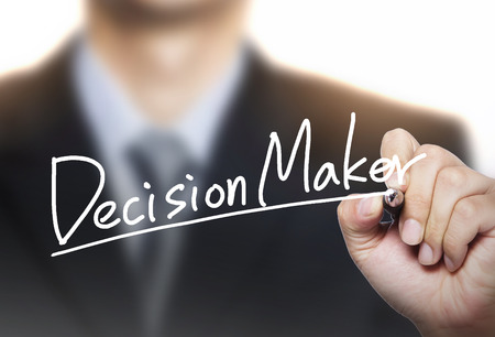 decision: decision maker written by hand, hand writing on transparent board, photo