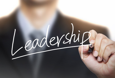 photo real: leadership written by hand, hand writing on transparent board, photo