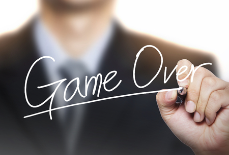 photo real: game over written by hand, hand writing on transparent board, photo Stock Photo