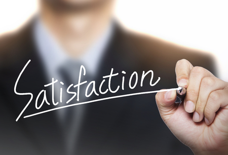 satisfaction written by hand, hand writing on transparent board, photo Stock Photo