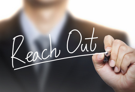 photo board: reach out written by hand, hand writing on transparent board, photo Stock Photo