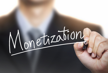 monetization written by hand, hand writing on transparent board, photo