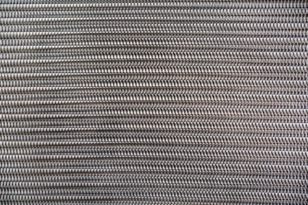 metal spring: Metal spring background, close up look of seamless springs Stock Photo