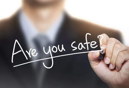 be careful: are you safe written by hand, hand writing on transparent board, photo Stock Photo