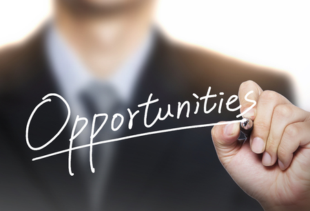 recruit suit: opportunities written by hand, hand writing on transparent board, photo Stock Photo