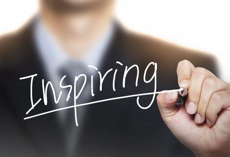 inspiring: inspiring written by hand, hand writing on transparent board, photo Stock Photo