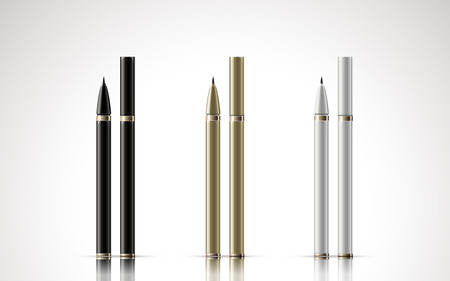 black, golden and white eyeliners, isolated white background