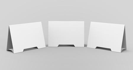 Blank table tent, 3d render table card set mockup for design uses, triangular paper card for business meeting or restaurant menu Foto de archivo - 97268719
