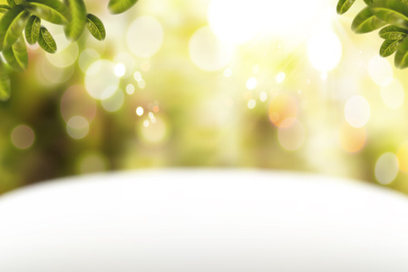 Glitter bokeh background with white table and green leaves elements in 3d illustration
