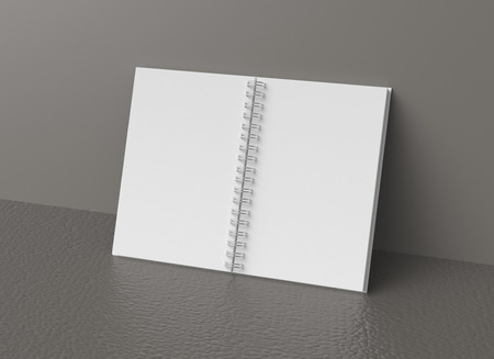 Blank notebook mockup in 3d rendering, white hard cover book lean on grey wall 写真素材