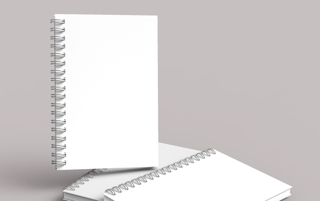 White hard cover notebooks on pale pinkish gray background in 3d rendering Banco de Imagens