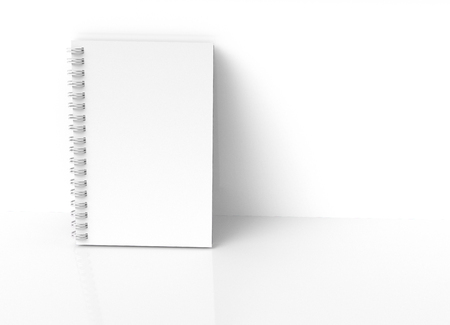 White hard cover notebook leaning on wall in 3d rendering