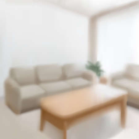 Blurred interior of living room with sofa set and wooden center table in 3D illustration 向量圖像