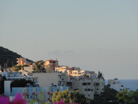 Village from Bali to Crete, in front of the sea. It is brightened up. Without character and outdoor.