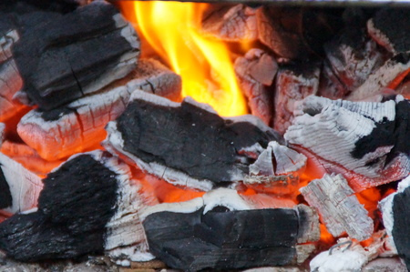 Embers - Embers are burning coals from the combustion of wood, coal, and other materials. This phase of combustion is a primary combustion that is less hot. Stock Photo