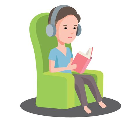 A young man stay at home and listen to the music with headset while reading a book. A man sitting on sofa reading book and listen to music