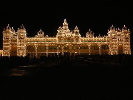 This city palace in Mysore, once occupied by the Maharajas, is illuminated once per week for one hour is more than 5000 lightbulbs. Stock Photo - 3551747