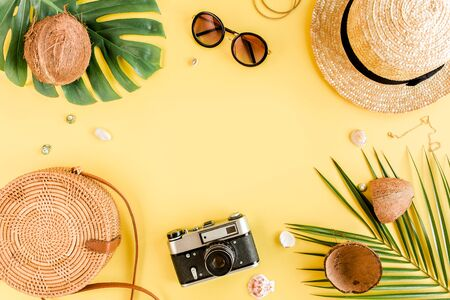 Womens accessories traveler on yellow background with blank space for text. Top view travel or vacation concept. Summer background.