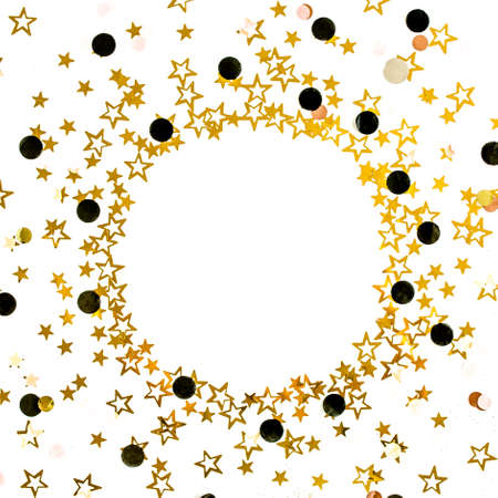 Gold stars confetti on a white, festive background. Colorful celebration, birthday background. Christmas or New Year pattern. Flat lay, top view Stock fotó