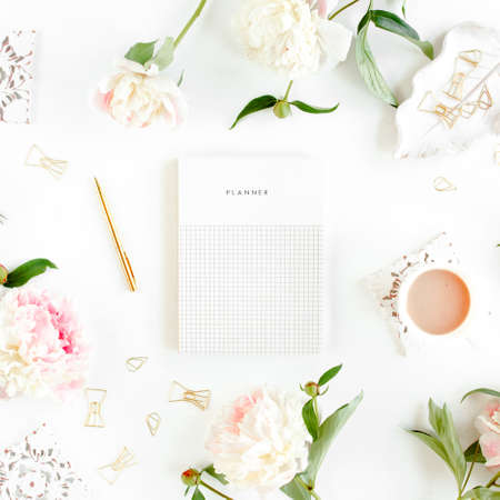 Workspace with diary, notebook, accessories, peony flowers on white background. Home office desk. Top view feminine background. Flat lay, top view.