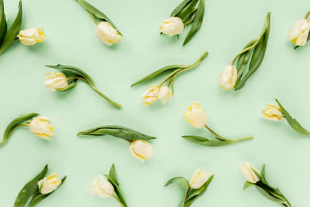 Floral pattern made of yellow tulip on green background. Flat lay, top view. Valentines background. Floral pattern. Pattern of flowers. 스톡 콘텐츠 - 155372806