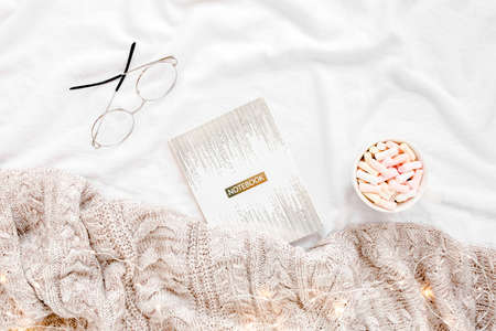 Home office on bed with warm plaid. Mockup card. Flat lay, top view Reklamní fotografie