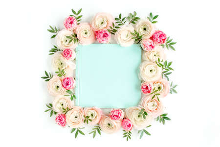 Floral pattern frame made of pink ranunculus and roses flower buds on white background. Flat lay, top view floral background.