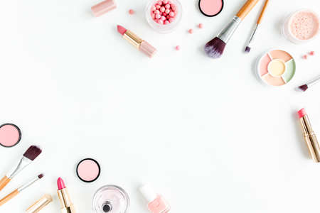 Professional decorative cosmetics, makeup tools brushes on white background. Flat composition beauty, fashion. magazines, social media. flat lay, top view. High quality photo