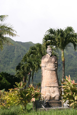 Genghis Khan statute in Chinese Cemetary with palm trees and mountains Editorial