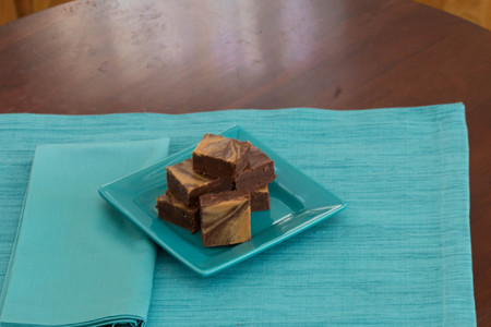 Swirled Peanut butter chocolate fudge on a square blue plate